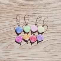 8 shell shaped stitch markers in blue, pink, orange, yellow & purple