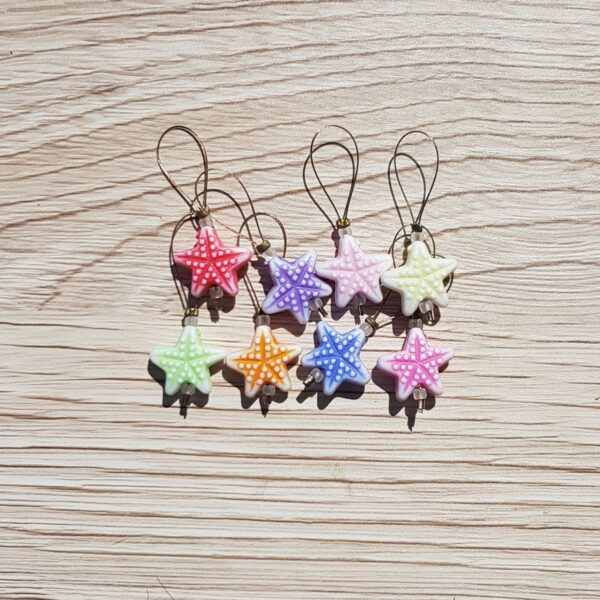8 starfish shaped stitch markers in blue, pink, orange, yellow & purple